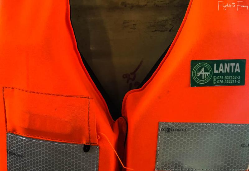 Koh Lanta ferry life vest with a Lanta sticker